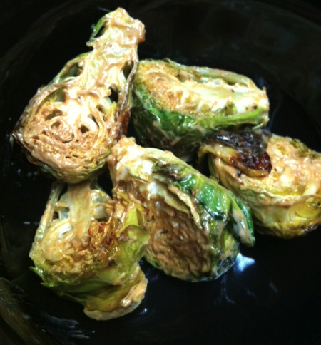 Dijon Brussels Sprouts These bad boys are SO good. Hot or cold.  Preheat your oven to 350. Slice them in half, and remove any loose leafs. Place them in a cooking tray, drizzle Olive oil on them and sprinkle salt and pepper on them.  Throw em in the oven for 40-45 min. 2TBS of Dijon Mustard into a bowl, add the cooked Brussels Sprouts and toss. Tada! Delish!
