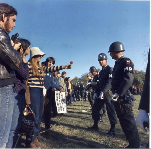 "todaysdocument:  ""A female demonstrator offers a flower to military police on guard at the Pentagon during an anti-Vietnam demonstration."" 10/21/1967 A quintessential image of the Vietnam war era, this photograph was taken on October 21, 1967 by Staff Sergeant Albert Simpson."