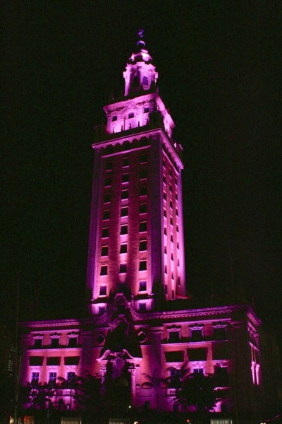 "The historic Freedom Tower in Downtown Miami illuminated in pink for Breast Cancer Awareness Month.  ""The Freedom Tower will be bathed in pink light as part of the The Estée Lauder Companies' Breast Cancer Awareness Campaign's Global Landmark Illumination Initiative. The Breast Cancer Awareness Campaign is partnering with major landmarks around the world to light the world pink over the course of 24-hours to kick off Breast Cancer Awareness Month and demonstrate support of this cause worldwide."" (source-The305.com)"