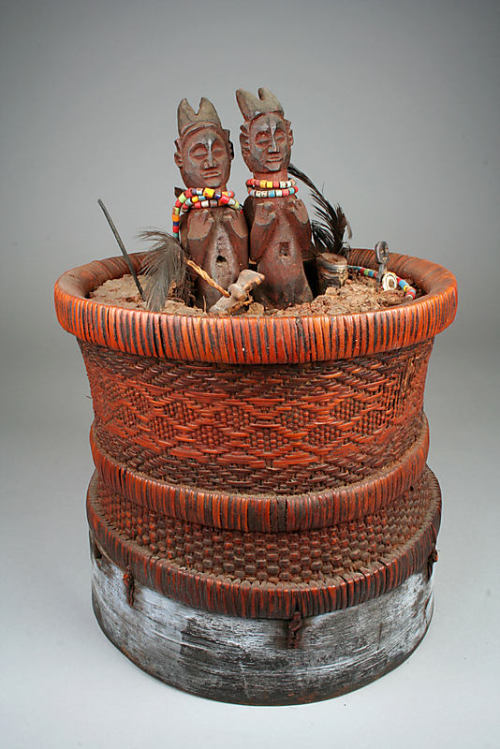 Holo Divination Basket 19th–20th century Democratic Republic of the Congo Rattan, mud, wood, beads, metals, feathers