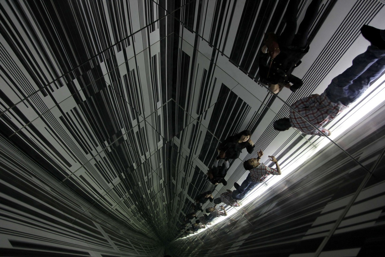 "Photos of the Day Visitors are reflected in mirrors at the installation ""Environment 3"" by artist Luc Peire at the Auckland Art Gallery, October 17, 2011. (Stefan Wermuth/Reuters)"