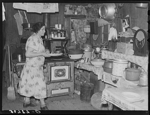 Mrs. Ole Thompson, wife of farmer, carrying food to the table. Williams County, North Dakota. Lee, Russell, 1903-1986, photographer. CREATED/PUBLISHED 1937 Oct.