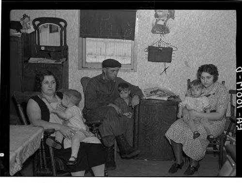 Part of the L.H. Nissen family of ten living in a three-room  shack. Rest of family at school. The whole house was of unusually high  humidity. The wife said they could not dry out the bedding because of  the poor ventilation. This is the living room and kitchen combined. Iowa. Lee, Russell, 1903-1986, photographer. CREATED/PUBLISHED 1936 Dec.