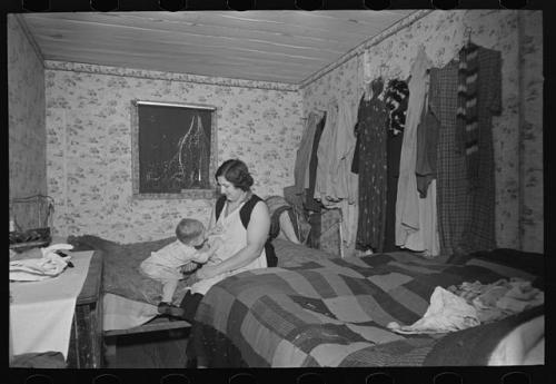 Mother and child in crowded bedroom of home of L.H. Nissen, hired  man. He is married, has seven children, one grandchild, all living  together in three rooms. Lee, Russell, 1903-1986, photographer. CREATED/PUBLISHED 1936 Dec.