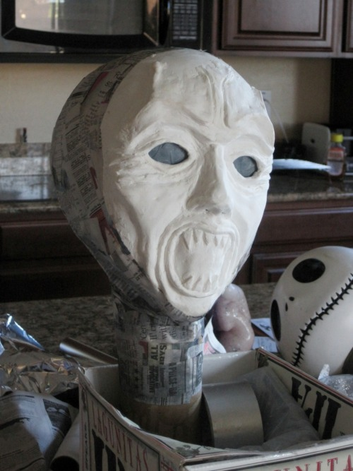 pigtailsandcombatboots:  My weeping angel sculpture (Halloween prop) coming to life. The face is supposed to be tilted, it's not crooked, like when they come after you, all evil with their eyes and mouth wide open, and their heads tilted, which makes it creepier for some reason. ;)