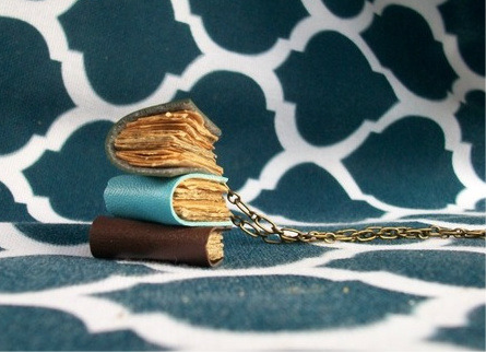 truebluemeandyou:  DIY Anthropologie Inspired Library Stack Necklace (inspiration here). I posted an Anthro Inspired Book Stack necklace here, but this tutorial from malmow looks much more like the inspiration piece. She used a headpin, old book pages or recycled paper, a necklace chain, and small leather strips. Tutorial at Craftster here.