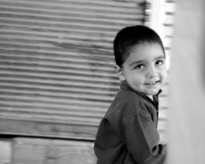 Adorable kid playing in the streets of Yazd, Iran