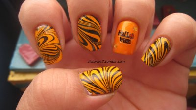 An orange and black water marble was pretty much inevitable this month.  Accent nail because I want to put these Halloween nail stickers to use! Colors used:  China Glaze - Papaya Punch Sally Hansen X-treme Wear - Black Out Sinful Colors - Cloud 9