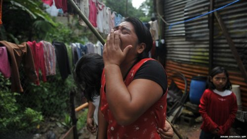 """Angela Saravia cries after recognizing the corpses of five of her relatives after a landslide at Boca del Monte village, in Villa Canales municipality, Guatemala. The number of dead in Guatemala has risen to 28, while the total rose to 13 in Honduras, and eight people have died in Nicaragua after a week of torrential rains triggered floods and landslides across Central America."" By: Johan Ordonez/AFP"