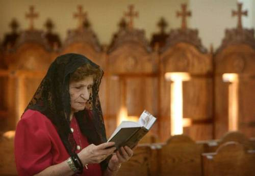 Agnes Dabbour, 80, of Corona, prays inside St. Andrew Orthodox Christian  Church in Riverside on Friday. The temple, which features Byzantine  Christian architecture, iconography and ecclesiastical furnishings, will  be open to the public for touring Oct. 15 and 16. This woman's family has been Orthodox in Jerusalem since forever. I'm not sure what brought them to the United States, but I know this parish has been enriched by having Agnes, her husband Khalil, and her daughters and grandchildren in the community. Photo: David Bauman, Press Enterprise.