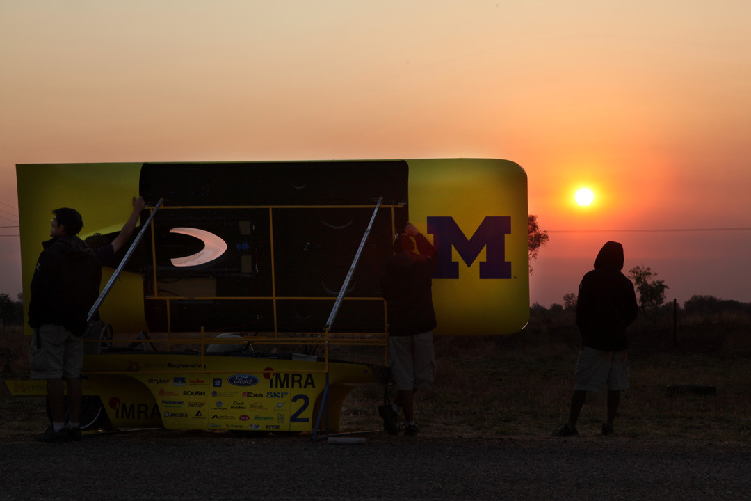 U-M solar car team charges solar car batteries at the morning of day three of the World Solar Challenge.  Photo by Marcin Szczepanski, Multimedia Content Producer/College of Engineering, U-M
