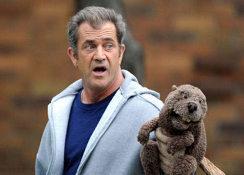 Mel Gibson during the filming of The Beaver  Despite his insane outbursts, Mel Gibson managed to deliver a decent performance in the Jodie Foster-directed The Beaver — about a failed husband and CEO who therapeutically bonds with a hand puppet. The uncanny similarities between Gibson's character and his off-screen self became strikingly apparent when these images of Gibson jogging on location during the production surfaced. The costume: Beaver puppet — $24, Highsmith Gray zippered hoodie — $13, Old Navy Blue tee — $6, Old Navy Sweatpants — $25, Old Navy Pepper spray (Because with eyes that crazy, you're really paranoid.) — $20, Mace Sneakers (to help you run from your failed career) — your closet    The Flavorpill Guide to DIY Halloween Costumes: Film Edition