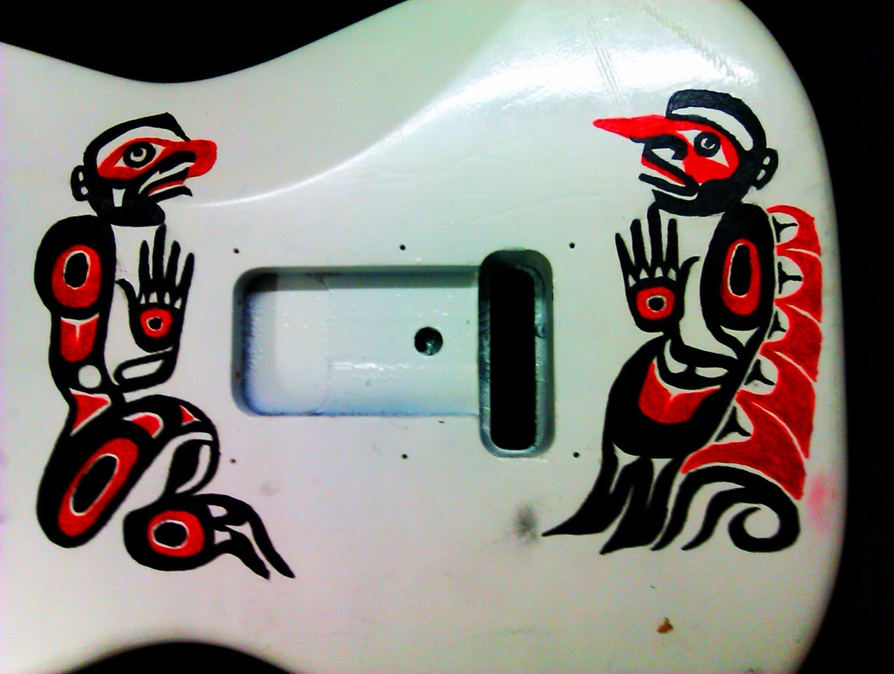 Here's a little treat, kinda. I started painting on the back of my guitar a few days ago, this is it so far, MORE TO COME!!!