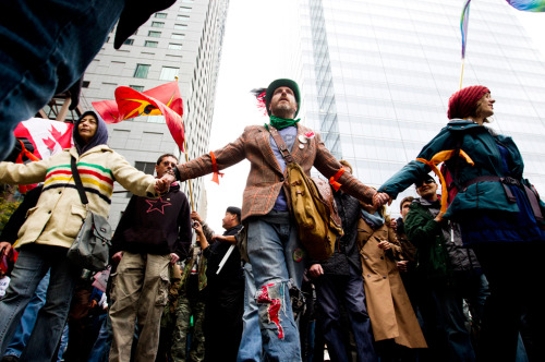 """Global protests against economic injustice gripped cities over the weekend, predominantly on Saturday, October 15. Solidarity with Spain's 'Indignants' and New York's 'Occupy Wall Street' protesters brought demonstrations over the concentration of wealth in the hands of a few and the worldwide economic crisis to cities from Hong Kong to Tulsa."" Boston.com    For more powerful images from this weekend's global protests, click here.    Image via Brent Lewin/Bloomberg."