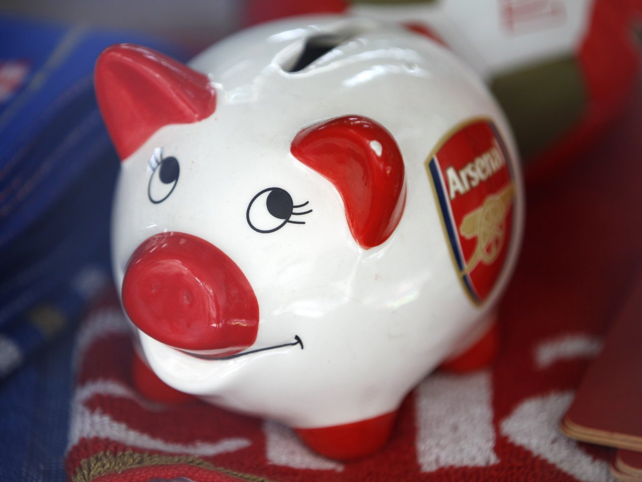 Here piggy, piggy, piggyA piggy bank branded with the logo of the English Premier League soccer club Arsenal is seen in a souvenir shop in London October 18, 2011. A future without relegation and promotion from and to the English Premier League would be akin to suicide, according to Manchester United manager Alex Ferguson. Photo: Chris Helgren/Reuters