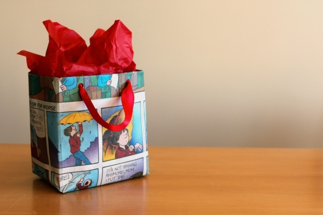 DIY newspaper giftbag, looks pretty and is cheap to make! http://yourstrulyg.wordpress.com/2011/10/16/diy-newspaper-gift-bag/