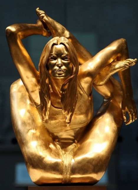 Gold statue of Kate Moss in a yoga position which sold for $908,245 at a Sotheby's auction.