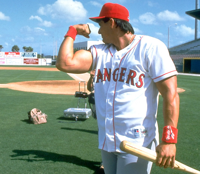Rangers outfielder Jose Canseco flexes his muscle before a 1994 spring training game between the Rangers and White Sox. The Canseco-less Rangers face off against the Cardinals Wednesday night in Game 1 of the World Series. (John Iacono/SI) CORCORAN: World Series full of surprising storiesCHEN: Texas has unfinished business in World SeriesLEMIRE: How Cruz found path to slugging stardomLEMIRE: The Cardinals improbable run to World Series