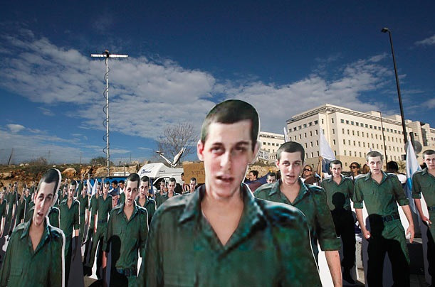 Bag's Take-Away:  See? One Gilad Shalit IS worth over a 1000 Palestinians. Pictures don't lie.   (photo: Ronen Zvulun / Reuters caption:In the deal negotiated for his release, Israel agreed to free approximately 1,000 Palestinian prisoners. Though the numbers may seem lopsided, such events are not without precedent. In 1985, Israel handed over 1,150 security prisoners in exchange for three Israelis captured during the war with Hizballah three years earlier.   (Via TimePhotos) ————— Topping LIFE.com's 2011 list of Best Photo Blogs, follow us at: BagNewsNotes; BAG Twitter; BAG Facebook; Bag by Email.