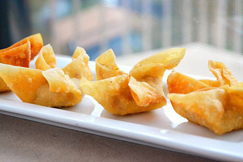 Bacon: We like it all wrapped up. Crispy Bacon and Onion Wonton Flowers | Just Putzing Around the Kitchen