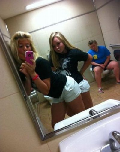 "collegehumor:  Girls Take Bathroom Photo With Sad Girl On Toilet ""You can sit on the toilet Meg, but at least make a kissy face for us."""