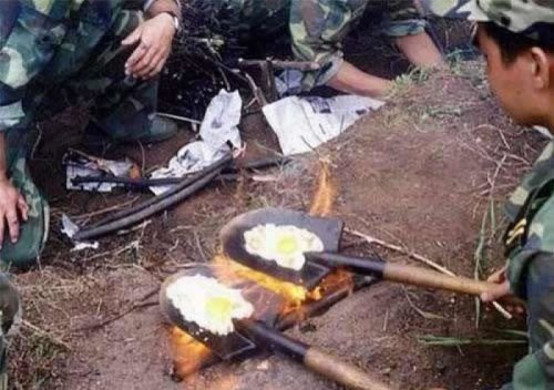 Cooking Eggs On A Shovel They're really regretting flinging that turd from the shovel earlier that day