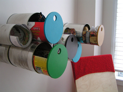 Tin Can Storage via The CANADIAN DESIGN RESOURCE I have shown many an aluminum can storage. And I love each and every one but this one designed by Canadian designer Cristina Covello takes the cake. The drawer system just make my inner Storage Geek squeal!