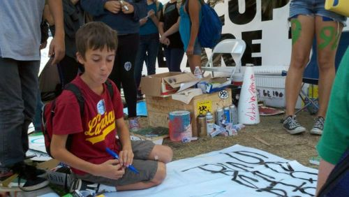 "latimes:  Students visit Occupy L.A. for lesson in democracy:  Avery Tyler, 12, said she was initially scared of the sprawling tents, but her perspective quickly changed. ""People care so much about this, they come down here and stay here,"" she said. ""One guy was talking to us and he said we're all doing this for the future children. That really made me feel proud.""  Photo: Nathaniel ""Nat"" Stern, 11, who attends the private Sequoyah school in Pasadena, visited Occupy L.A. on Tuesday as part of a field trip to City Hall. Credit: Matt Stevens / Los Angeles Times"
