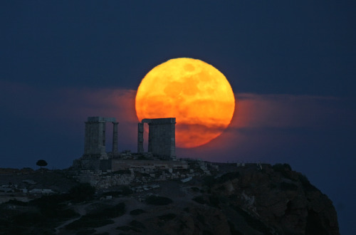 cwnl:  Moonrise at Temple of Poseidon A harvest moon, or the full moon that occurs closest to the autumnal equinox, is seen rising behind what's left of the ancient ruins at the Temple of Poseidon in Greece. Image Copyright: Chris Kotsiopoulos