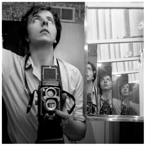 Vivian Maier ©  Untitled, Self Portrait.      A riddle, wrapped in a mystery, inside an enigma.  A person who fit the stereotypical European sensibilities of an independent liberated woman, accent and all, yet born in New York City. In her leisure Vivian would shoot photos that she zealously hid from the eyes of others. Taking snapshots into the late 1990′s, Maier would leave behind a body of work comprising over 100,000 negatives. Maier's massive body of work would come to light when in 2007 her work was discovered at a local thrift auction house on Chicago's Northwest Side. From there, it would eventually impact the world over and change the life of the man who championed her work and brought it to the public eye, John Maloof.