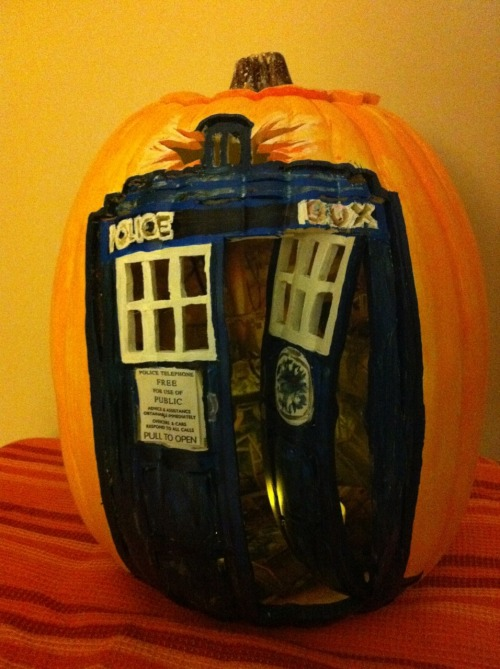 "Doctor Who TARDIS pumpkin with working door(!)  wearableart4sale: Yes the inside is larger than the outside. It is amazing these white synthetic pumpkins. Hayley my daughter and I spent over 2 hours or even 3 hours looking in about 4 pumpkin patches looking for a ""Tardis"" pumpkin until we finally found one. I think we paid about ""$18.00 and but then when we realized how much time we were going to put into carving the pumpkin thought, gee it will rot and be gone in a week and that is no fun… So we went to Micheal's got a white synthetic pumpkin and did a bunch of creative carving.  The ""Police Box"" words were challenging. We would do it differently next time for sure. We wish we had seen that gal's pumpkin carving patterns before we had started carving our own design.  Oh well. This is my first "" Tardis"" attempt. Not my first pumpkin attempt. My first synthetic pumpkin I have to admit. I am a purist when it comes to Halloween, but this design was too complicated to not use a real pumpkin.  Anyhow, if you like it reblog it. Hope you do. Cheers. There are 4 photos in all showing the work in progress. The 4th photo is of the original drawing. Closed doors, doors open without details inside and the details inside.   WearableArt4sale copyright by B. Heather McLean and Hayley B. McLean  It's Wholloween!"