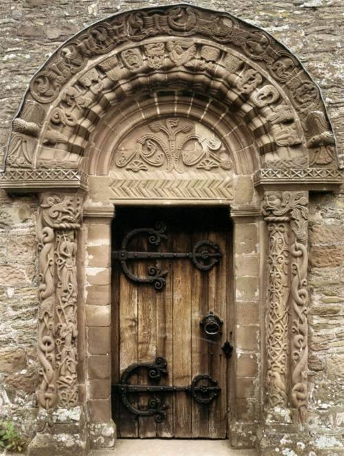 contentsofafaeriespocket:  *___* Such an ornate door…  Look at the iron work holding it at the hinge!  Beautiful!  Kilpeck Church (aka the Parish Church of St Mary and St David in Kilpeck), located in Herefordshire near the Welsh border, is home to the finest collection of Romanesque sculpture in England. It was built in about 1140 and has survived remarkably intact and unaltered to the present day. [Here]