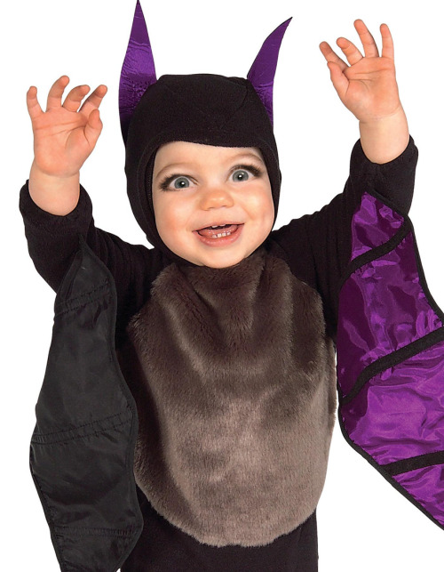 A baby dressed like a demon with Michele Bachmann eyes.