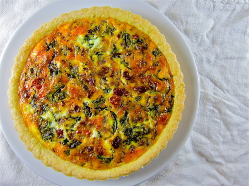 Arugula and bacon quiche.