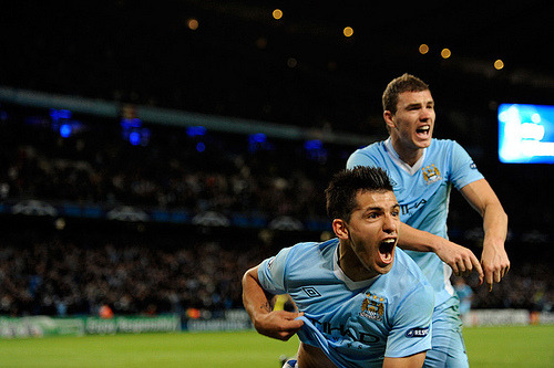 "thebeautifulgameblog:  Manchester City's Sergio ""Kun"" Aguero celebrates after scoring a goal during an UEFA Champions League match against Villareal. credit: Ryu Voelkel"