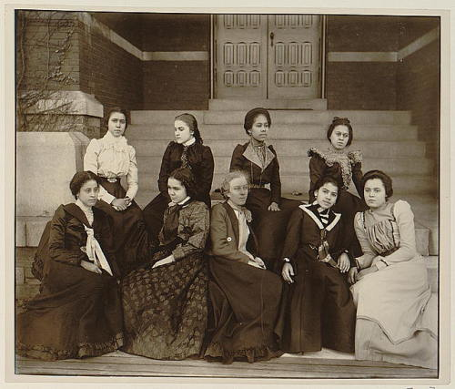 Nine African American women, full-length portrait, seated on steps of a building at Atlanta University, Georgia ca. 1900 Thomas E. Askew, photographer