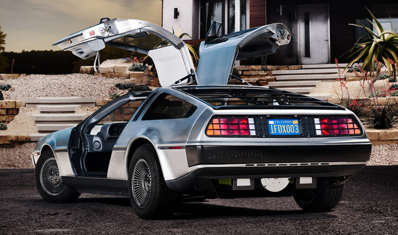 """electric dolorean [sic] goes back to the future"" a DC-type electric motor with front-weighted battery achieves 0-60mph (0-100km/hr) in 4.9 seconds, with an alleged top speed of 125 mph (201 km/hr). DMC plans to offset the extra weight of the electric system by manufacturing the vehicle's underbody with a lightweight resin-infused composite.  ____________________ If there's any car that could pull this off, a DeLorean is certainly appropriate to be retrofitted as an electric vehicle. At least from a styling-perspective it was already, ahem, slightly ahead of its time. As the price of gasoline makes its steady increase in price, which it has continued to do since the 70's, the trend for cars originally manufactured with internal combustion engines to become hybrids or strictly electric vehicles will only gain in popularity. The effect, hopefully, will be that the 100 year reign of fossil fuel terror will slowly loosen its grasp of this planet. It may sound like hyperbole but the truth of the matter is that we do need to let go of this archaic energy source and transition to more renewable methods for the energy we need. Especially considering that crude oil also goes into every manufactured thing we use. It's very unlikely that the future supply of oil will meet the demands of a growing global population. Think Occupy Wall Street with a billion more people being screwed over by the companies responsible for extracting, refining, and distributing the oil from the earth. But, can we blame the oil companies, when the demand for change can barely be heard over the glorious screaming roar of an American, German, or Italian turbocharged V8 engine? The sound that engine will make when it runs out of gas is the same sound of an electric DeLorean sitting idle at a stoplight. When the light turns green, only one car will proceed into the future. And it won't be powered by gasoline."