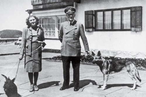 "Love is famously blind; if Eva Braun and Martha Dodd are any indication, it is also willfully ignorant. Both women were afflicted with a chronic romanticism that warped their logic and inured them to the catalog of abominations taking place around them. Blame it on their dizzy blondness. Blame it on an excess of devotion — always becoming in a woman. Dodd went on to write about her years in Berlin and seems to have chalked up her attitude to immaturity; Braun has been written off as an innocent bystander. In fact, their solipsism was part of a larger scheme, in which matters of government and war were the province of men, and being oblivious to them was a woman's prerogative. It ratified their femininity, this capacity to look the other way. What I Did for Love — that's a list that many if not most women would just as soon forget. Braun and Dodd outdid themselves in this division. In the final weeks of the war, the party that had been sequestered at the Berghof moved to the bunker in Berlin, 2,150 damp square feet carved into 15 poorly ventilated rooms. Braun reveled in her role as hostess. ""Very happy to be near him, especially now,"" she wrote to a friend. She might easily have escaped, as Hitler urged her to do. Instead, she insisted on dying with him. She was 33. In letters to friends, she embraced her fate, as if a place in history alongside a failed despot whose name would become synonymous with evil were the finest outcome she could imagine for herself. Hitler married her there in the bunker, followed by a brief Champagne reception. They poisoned the dog first, to see if the pills worked. By this time, telephone connection to the outside world was lost and the Soviet army had reached the Reichstag. Hitler took poison and shot himself in the temple. Braun chose cyanide over a bullet, she explained, because she wanted to be a beautiful corpse. Their bodies were doused with gasoline and burned, buried in a bomb crater in the garden. (via Romancing the Reich)"