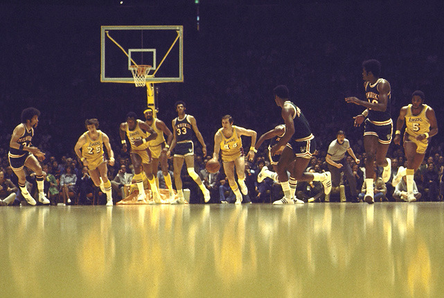 Lakers guard Jerry West leads a fast break as Wilt Chamberlain (white headband) and Kareem Abdul Jabbar (No. 33) look on. The photo was taken from a 1973 game between the Bucks and Lakers. (Walter Iooss Jr./SI) GLICKSMAN: West's new biography dishes on Phil Jackson, Kobe, ShaqGALLERY: Iconic photos of the Lakers