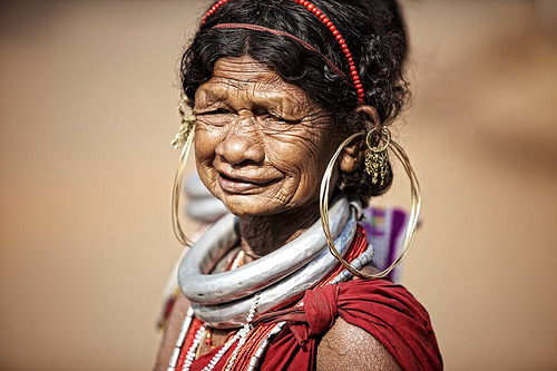 muslimmafia:  Gadaba tribe, Orissa, India (by ingetje tadros) GADABA TRIBE. Gadaba women wear neck rings which are about 500-700 gms each & can not be removed without the help of the Blacksmith. As a part of their tradition, it is only removed after their death. The Gabada tribe is reckoned as one of the oldest and jovial tribes in India. These Gabada tribes mostly are located in the southern fringes of the Koraput district. Apart from being singularly attractive tribe Gadabas are also friendly and hospitable. Their villages with square or circular houses and conical roofs and gaily dressed women, present a picturesque sight. It is believed that they have their ancestral home in the north Vindhya mountain ranges. In fact Gabada has got a link with Gada, which is a name of brook or a streamlet found in this portion of the Indian Territory. The houses of these Gabada truly reflect their cultural heritage. The society of the Gadaba tribe can be best understood in the villages. Each community is headed by a leader. Their main occupation is agriculture but they also give due importance to cattle rearing. The social set up this tribe is also interesting because it has unique rules for marriage and even building houses. Agriculture is the main occupation of the Gabada tribe, thus making their society an agrarian one. Moreover, some of them involve in other activities like gathering forest products, fishing and hunting. They use animals and its products for various purposes. The cows and buffaloes are utilized mainly for ploughing. They do not milk the cows, as they believe it reduces the strength of the animals. The Gadabas also regard cattle-raising as the true source of their wealth. They believe in sacrificing pigs, cows and buffaloes at the altar of their Vanadevata (god of the jungle). Almost every family rears pigs irrespective of its status and size and keep dogs to ward off evil spirits. A Gadaba woman usually wears a two-piece dress which is very colourful, often striped in red, blue and white, which is woven by the women themselves. The textile is made from the bark of the kereng plant. The ornaments they wear are not very different from those of other tribals. They wear beads of various colours in the hair, silver necklaces and very big brass earrings. The kerengis are being slowly replaced by the sari. Men wear only a piece of cloth `Languti` with a flail which hangs in front. The religion of the Gadaba tribe is basically Hindu. This particular tribe worships several gods and goddesses. Religious festivals form an interesting as well as important part of their lifestyle. They worship an array of gods and goddesses. They celebrate festivals and occasions like Dussehra, andapana parab and chaita parab. These Gabada tribes have developed their own language, which is popularly known as Gutub. Orissa, India.