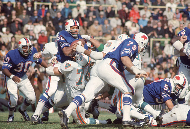 Bills running back O.J. Simpson in stuffed by Dolphins lineman John Richardson during a 1970 game between the Bills and Dolphins. (John Hanlon/SI)BANKS: See how the Dolphins and Bills stack up in this week's Power RankingsKING: Impact of Palmer trade will be felt for years | Podcast with Alex Smith