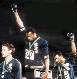 "#Madison Civil Rights Icon John Carlos to Visit Occupy Madison 4:30pm Thursday 10/20  - Who is John Carlos? ""He was the bronze-medal winner in the 200 meters at the 1968 Summer Olympics and his black power salute on the podium withTommie Smith caused much political controversy. ""  Occupy Madison's facebook page / twitter / web site / google map to site Here is a Youtube video about his memoir The John Carlos Story  - which he'll talk about @ 7:30PM at the Madison Public Library Interview with John Carlos at Democracy Now."