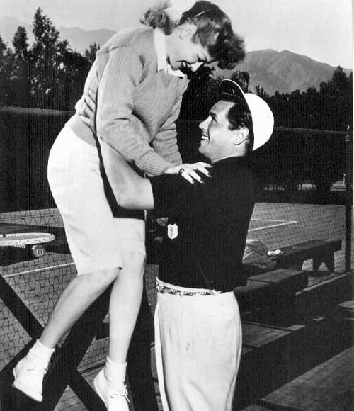 Lucy and Desi on a tennis court.