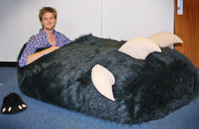 "Awe. Some. bucktheduck:  Monster Slipper of the Day: Tom Boddingham is the proud owner of a brand new monster's paw-shaped bed. One problem, though: He ordered a slipper. Boddingham says the Chinese company that manufactures the slipper missed the decimal point in his custom order: He wanted a size 14.5 left, but got a size 1,450 instead. ""It was sent directly from Hong Kong and measures 210 x 130 x 65cms – the same length as a grizzly bear or a family car,"" the 27-year-old from Ilford, East London, is quoted as saying. ""I reckon I must be the owner of the biggest slipper in the world."" The company has since apologized to Boddingham, and promised to send him a replacement slipper. Asked why the request for a XXXXXXXXXXXXXXXXL monster's paw didn't raise any flags, a spokesman said the employees thought it was meant as a prop for a window display. [mirror.]"