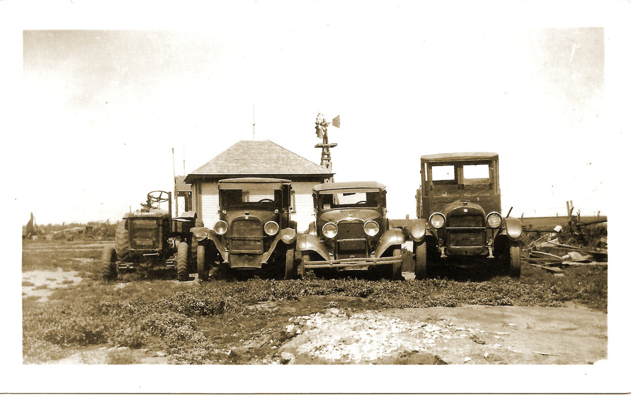 Farm vehicles all in a row. Alva, Oklahoma, early 1900s