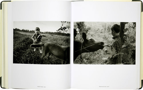 Inside layout from Larry Towell's The World From My Front Porch,  2009—hands down my favorite of his many endeavours. It's a collection  produced over twenty years that weaves together the themes of homeland  and belonging, and a romantic expression of the world seen from the  family home's viewpoint. It's a photo essay that deals with his Arcadian  heritage, the family farm he sharecrops in Ontario, and the beauty of  the day to day rambling. It's also illustrated with a whole host of  archival photos and historical artifacts. Cannot recommend it enough.