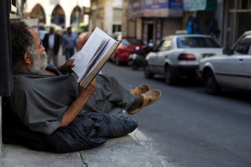 old Arab man reading book. Amman, Jordan by RvDario on Flickr.