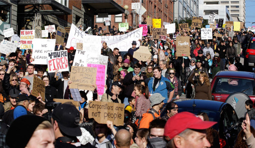 """Protesters with the 'Occupy Seattle' movement  march, Saturday, October 15, 2011, near the Pike Place Market in  downtown Seattle."" [via The Atlantic] More photos here. This is amazing. The whole world is Occupying. [Photo by Ted S. Warren]"
