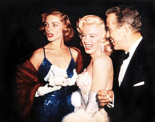 Lauren Bacall, Marilyn Monroe and Humphrey Bogart at the How To Marry A Millionaire premiere on November 4, 1953 in Los Angeles, California