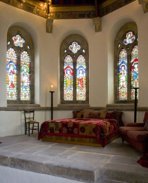 Bedroom in a former English church turned private home…. the stained glass windows are gorgeous (via Revamping God's home into your own: Holy home in the UK | Freshome)